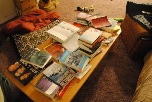 A sturdy coffee table, punished with mounds of books