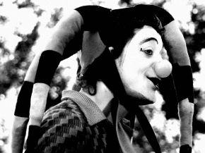 A black and white clown portrait.