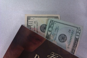 Book bookmarked with money