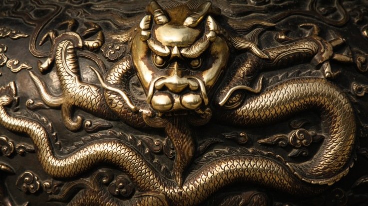 Brass relief of Asian dragon